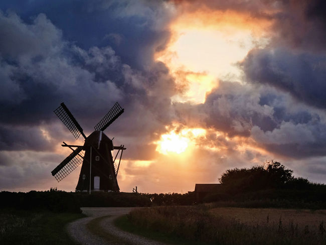 Klostermøllen windmill during sunset. Vestervig Kloster mill is a Dutch windmill from the year 1850. It was restored in 1992 and it runs when weather permits. Windmill Denmark Tourist Attraction  Alternative Energy Architecture Renewable Energy Rural Scene Sunset Thy Traditional Windmill Wind Power Wind Turbine