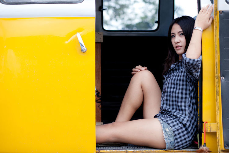 Portrait of woman sitting in land vehicle