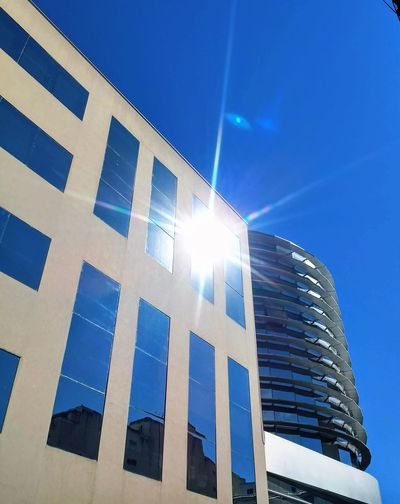 Architecture Blue Building Building Exterior City Clear Sky Day Low Angle View Modern No People Office Building Exterior Sky Sunbeam Sunlight Sunny Window