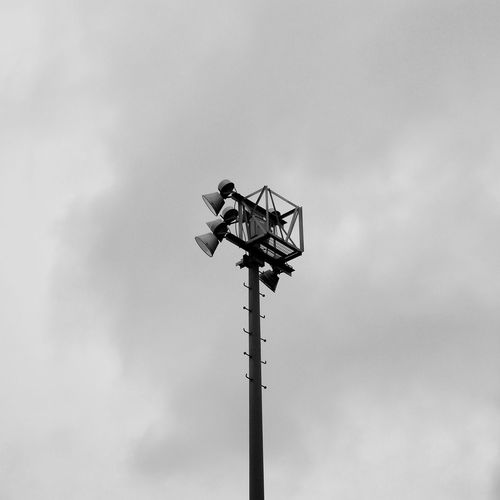 Black And White Day Dramatic Sky Lighting Equipment Low Angle View Minimalism No People Outdoors Sky Stadium Lights Technology The Street Photographer - 2017 EyeEm Awards