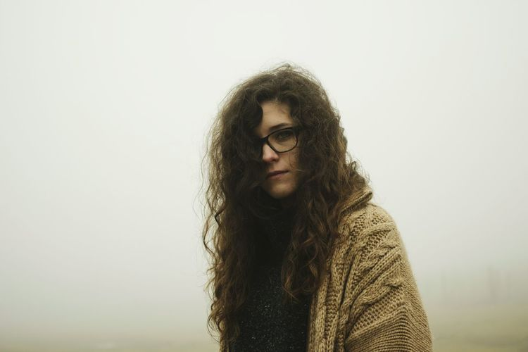 Portrait of young woman in fog