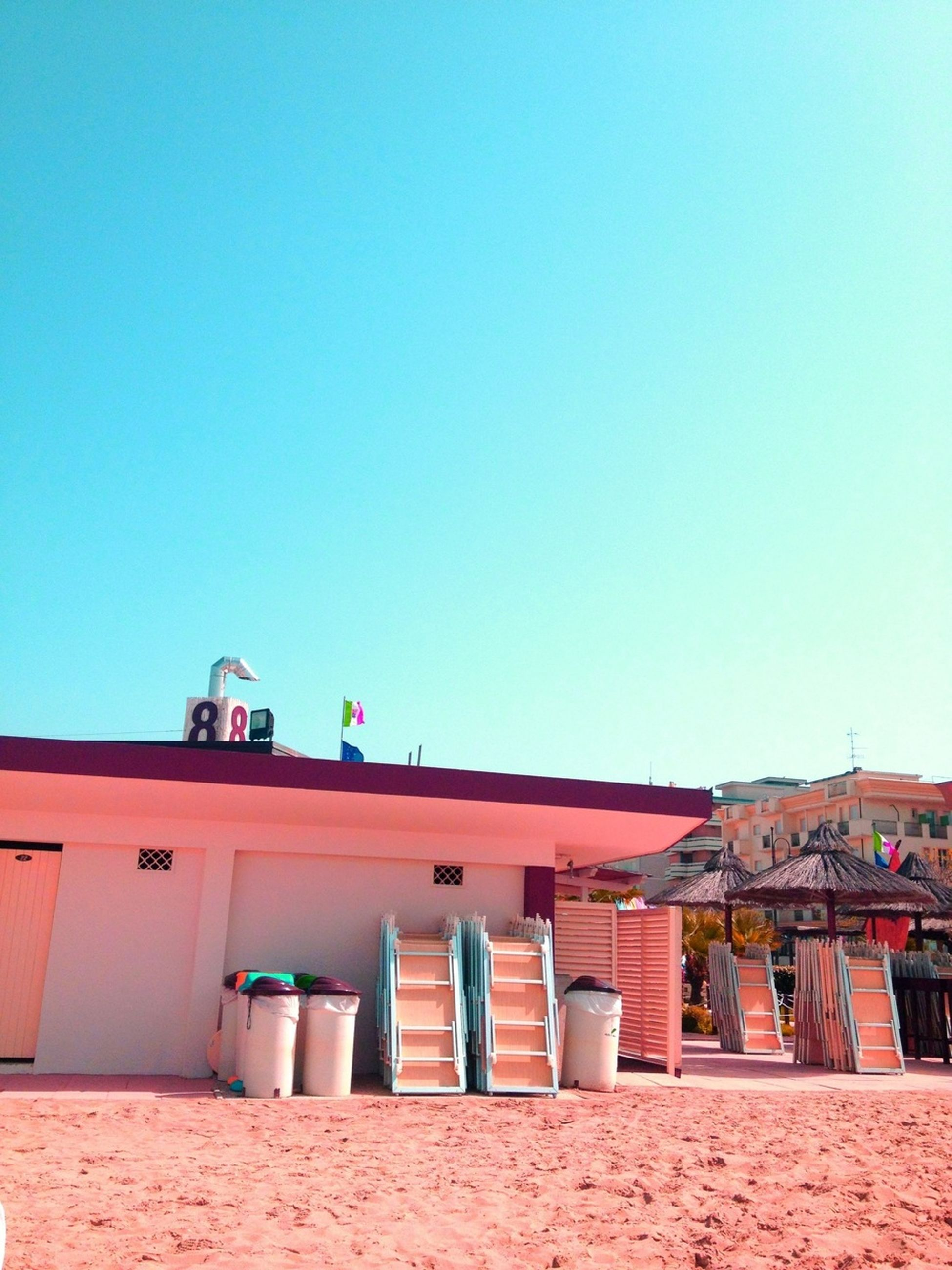 architecture, building exterior, built structure, clear sky, copy space, blue, roof, house, low angle view, residential structure, sunlight, day, residential building, outdoors, exterior, building, high section, no people, roof tile, facade