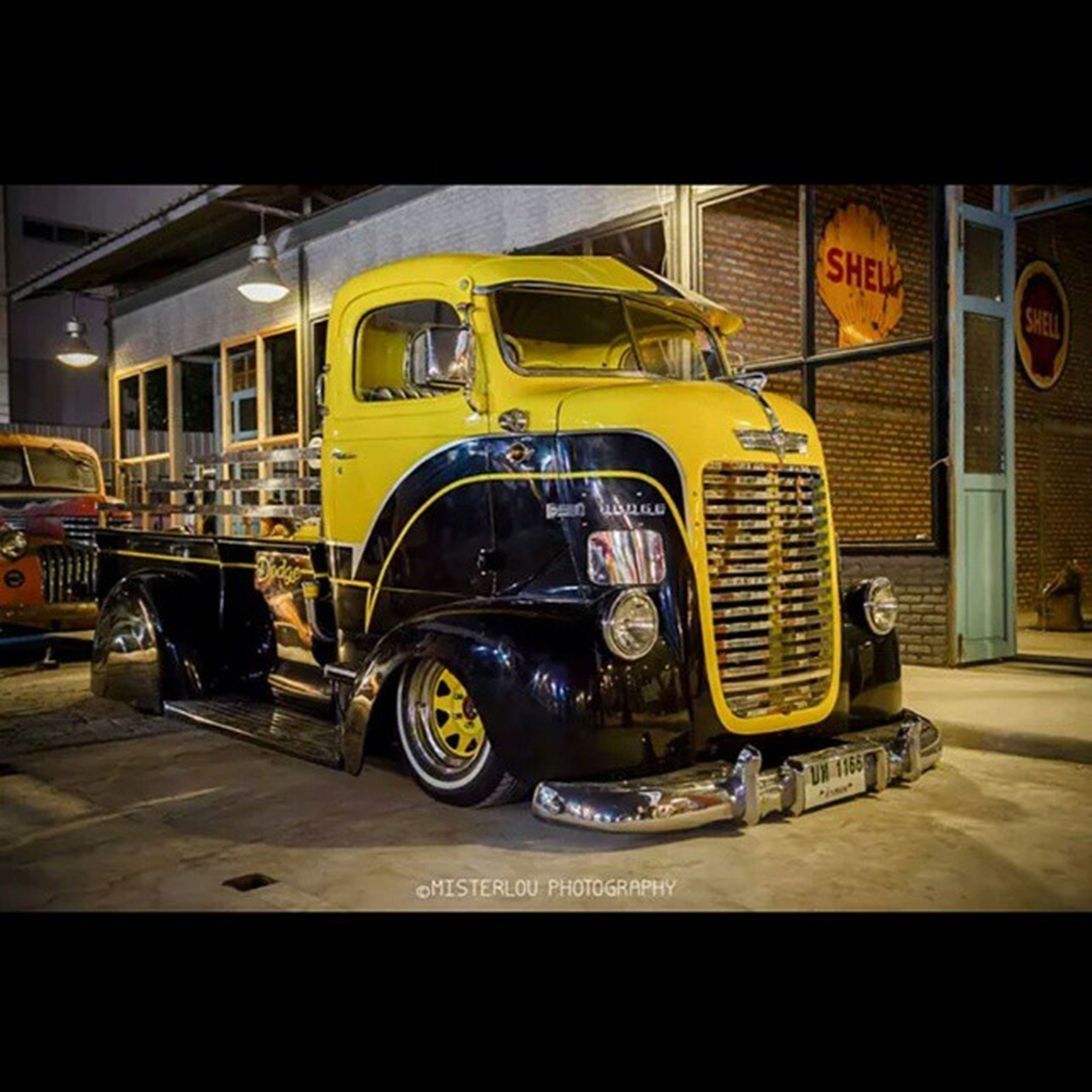 transportation, mode of transport, land vehicle, public transportation, architecture, car, built structure, travel, building exterior, yellow, street, stationary, train - vehicle, city, incidental people, men, bus, outdoors, on the move