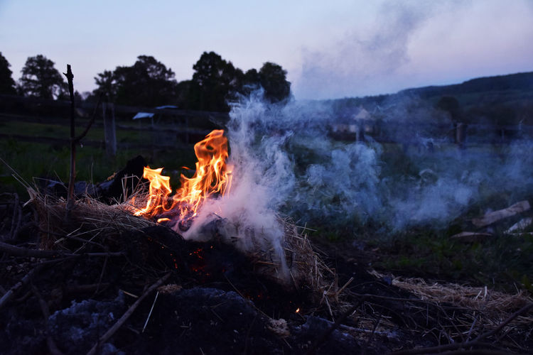 Bonfire on land during sunset