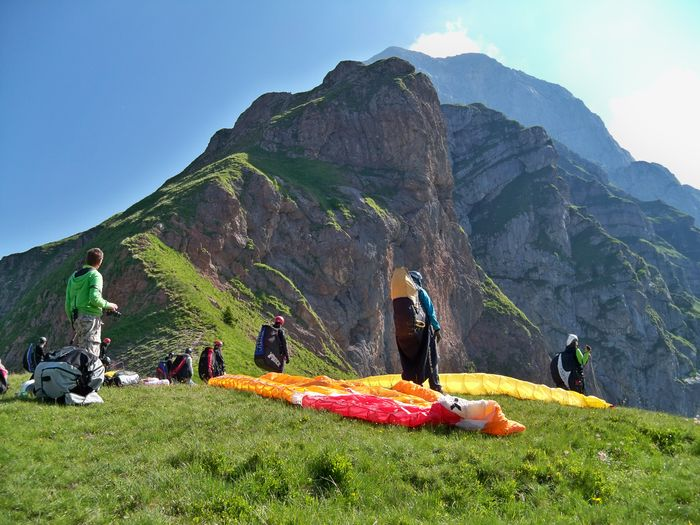 Adventure Beauty In Nature Clear Sky Day Full Length Grass Landscape Leisure Activity Lifestyles Medium Group Of People Men Mountain Mountain Range Nature Outdoors People Real People Scenics Sky Standing Sunlight Togetherness Vacations Women