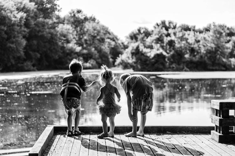 River. Childhood Full Length Boys Rear View Two People Child Real People Togetherness Day Outdoors Leisure Activity Children Only Lake Standing Water Playing People Friendship Nature Adult
