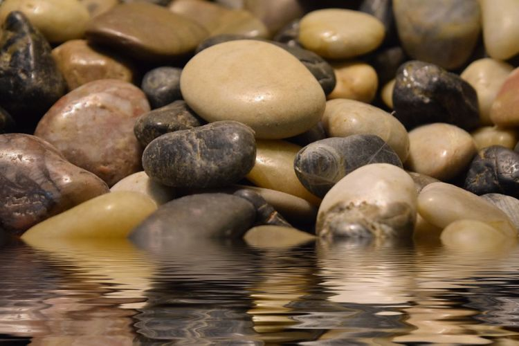 Full frame shot of pebbles in water