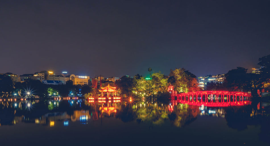 Hanoi Illuminated Water Reflection Night Sky Architecture Built Structure Waterfront Building Exterior Nature City Tree No People River Copy Space Building Outdoors Plant City Cityscape