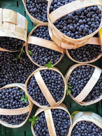 High Angle View Of Blueberries For Sale At Market Stall