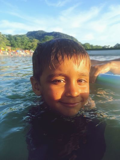 Portrait of boy swimming in sea