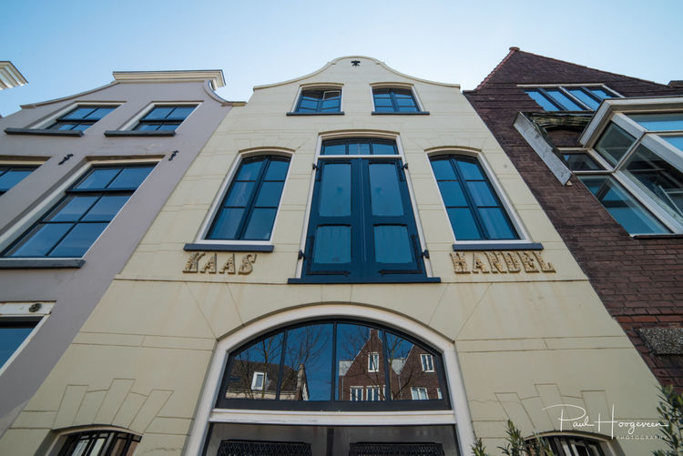 Old cheese warehouse Architecture Built Structure Building Exterior Window Low Angle View Building Sky Day No People Nature Residential District Clear Sky City Outdoors Glass - Material Façade Sunlight Reflection Arch Blue Apartment