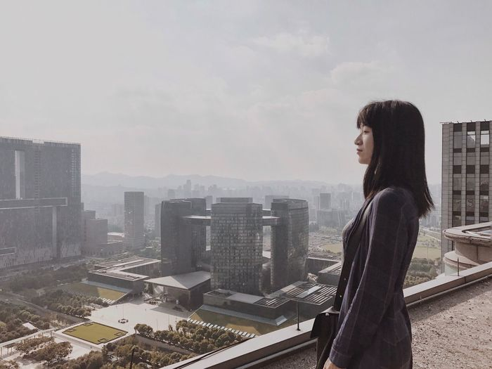 Architecture Skyscraper Building Exterior Built Structure One Person Cityscape Real People Standing Outdoors Lifestyles High Angle View Rooftop ThatsMe Standing