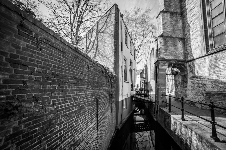 Behind the church Architecture Brick Built Structure Brick Wall Wall Building Exterior Wall - Building Feature Railing Direction Day Bare Tree The Way Forward No People Staircase Building Outdoors Connection Tree Footpath Nature Canal Alley Long