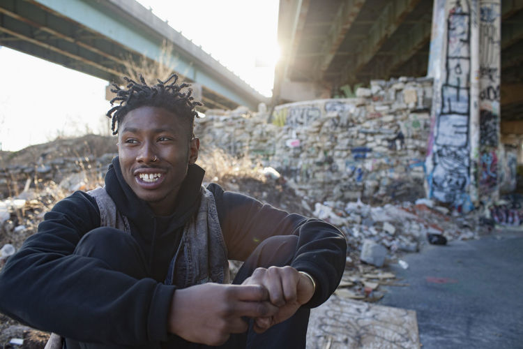 Portrait of smiling young man in city