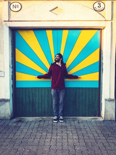 shining Smiling Sun Gate Gateway Retro Style Sunshine ☀ Sunshine Man Male Model Shining Shining Like The Sun Pastel Colors Door Decorations Doorporn Door EyeEm Selects One Person Front View Portrait Standing Multi Colored Casual Clothing Building Exterior Day Built Structure Architecture Real People Full Length Outdoors Lifestyles