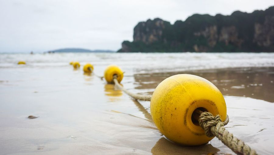 The buoy on the beach Beachphotography Beach Travel Thailand Water Yellow Beach Land Focus On Foreground Sea Nature No People Sand Sky Outdoors Close-up Buoy Beauty In Nature Wet Day