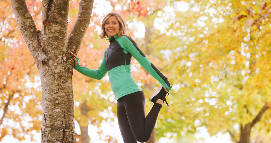 Autumn Beauty In Nature Day Exercising Focus On Foreground Full Length Happiness Healthy Lifestyle Leaf Leisure Activity Lifestyles Low Angle View Mid Adult Mid Adult Women Nature One Person Outdoors Portrait Real People Smiling Sports Clothing Tree Women Young Adult Young Women
