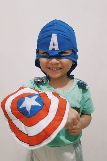 Captain America Carefree Casual Clothing Cheerful Childhood Cosplay Costume Day Elementary Age Front View Innocence Joy Leisure Activity Lifestyles Looking At Camera Person Portrait Roleplay Smiling Waist Up
