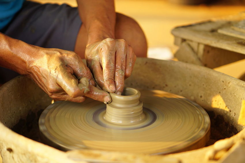 Business Stories Pottery Pottery Art Pottery Wheel Potterymaking Pottery Village EyeEm Selects Human Hand Making Clay Human Body Part Mud Working Molding A Shape Craft Art And Craft Spinning Craftsperson Shape Occupation Skill  Creativity Wet One Person Earthenware Adult Men