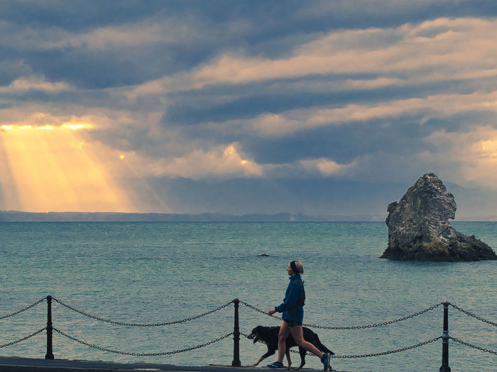The joy of walking the dog along Rocks Road Walking Dog Dog Rocks Road Nelson Moments Of Happiness Sky Cloud - Sky Water Sea Beauty In Nature Real People Scenics - Nature Sunset Railing Leisure Activity Horizon Over Water Nature Horizon One Person Tranquility Lifestyles Tranquil Scene Land Idyllic Outdoors New Zealand