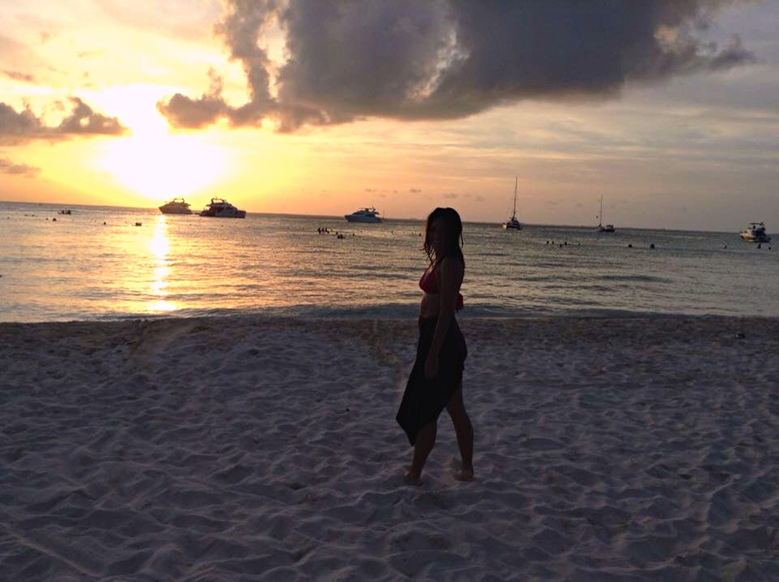 sunset, sea, beach, sky, water, shore, horizon over water, cloud - sky, lifestyles, leisure activity, scenics, full length, sand, cloud, beauty in nature, men, sun, standing