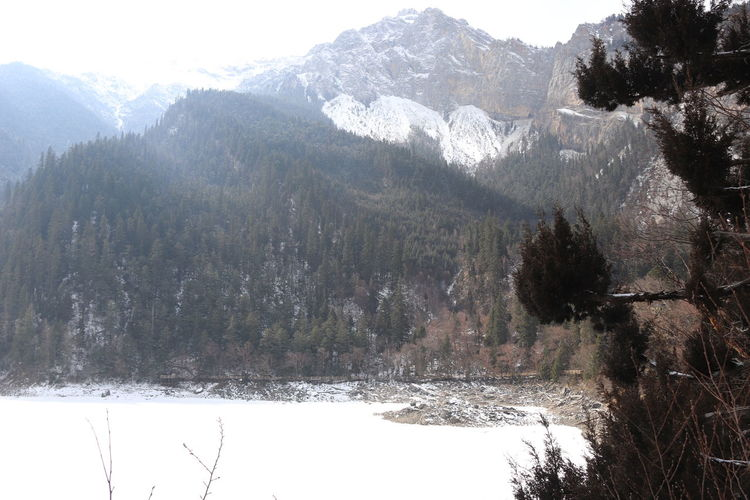 Scenic view of snowcapped mountains during winter