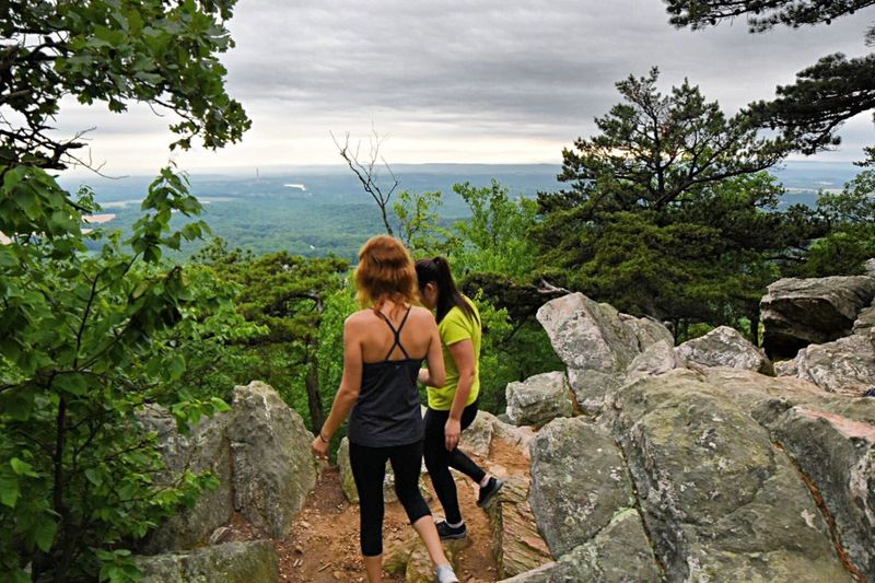 Supergirls. Rock - Object One Person Only Women One Woman Only Tree Rear View Cloud - Sky Adventure Outdoors Adult Day Adults Only Sky People Nature Full Length Hiking Backpack Standing Women Focus On Foreground Freshness Nature Beauty In Nature Tranquil Scene