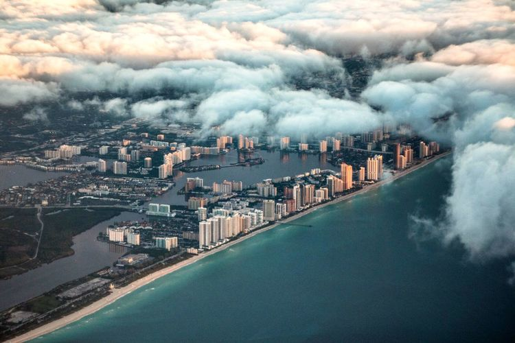 Battle Of The Cities Miami Miami Beach Florida Florida Life Building Exterior City Cityscape Cloudscape Sea Aerial View Cloud - Sky Scenics Travel Destinations Cloud Waterfront City Life The Great Outdoors - 2017 EyeEm Awards
