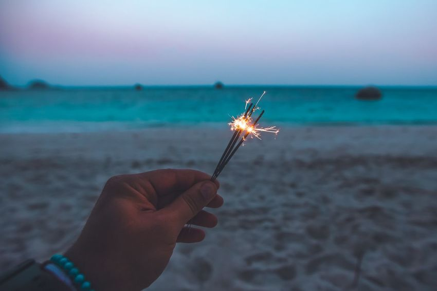 Beachlight Human Hand Human Body Part Holding One Person Real People Personal Perspective Flame