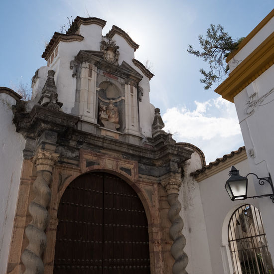 Arch Architecture Architecture Bell Tower Building Exterior Buildings Built Structure Cross Day Low Angle View No People Ocher Ocher Color Ochre Ocre Outdoors Place Of Worship Religion Sky SPAIN Spirituality