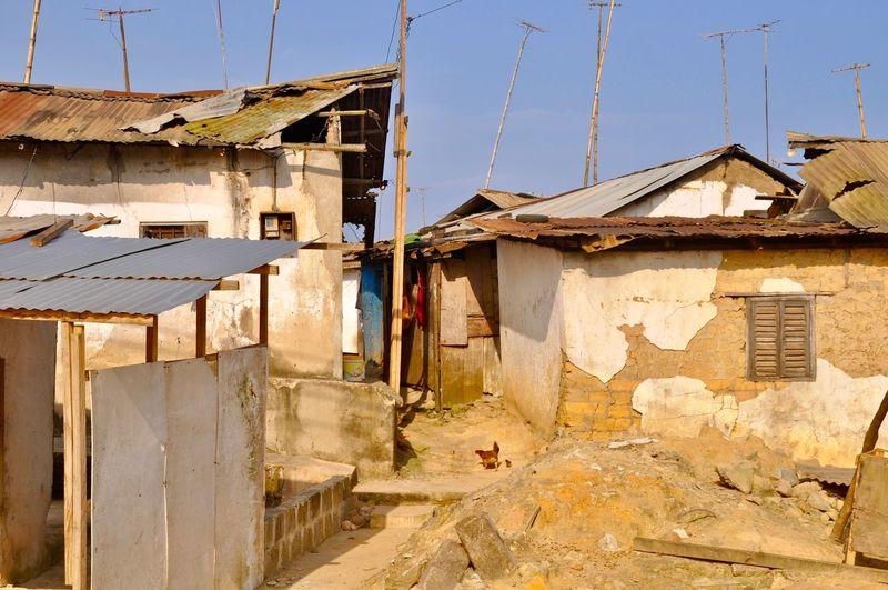 Old buildings against sky in village