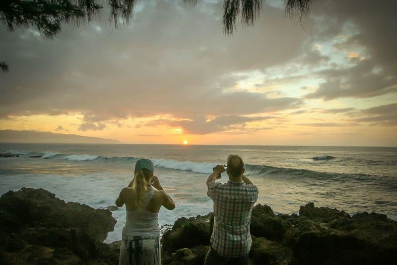 It was during a holiday this autumn. Had a hot and sad day. This couple captured the moment when my day turned into bliss and a feeling of appreciation of life and the highs and lows Showcase: November Sunset Hawaii Oahu, Hawaii Hanging Out Taking Photos Hello World Relaxing Enjoying Life Silent Moment Couples Photo Shoot Beachphotography Couples Sea And Sky Sea View Seascape Seaside Mobile Photography Sunset Photography Oahu Hawaii Hawaii Life Hawaii Sunset