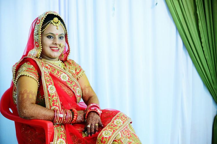 EyeEm Selects Traditional Clothing Sari Beauty Wedding Bangle Curtain Wedding Ceremony Bride Red EyeEmNewHere Close-up Gold Colored Headshot Looking At Camera Beautiful People Beautiful Woman Indoors  Happiness