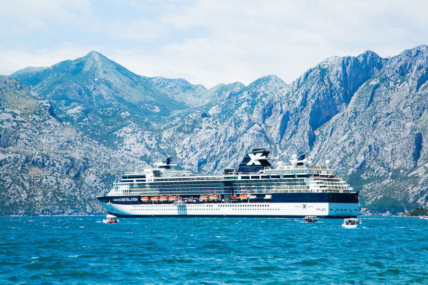 Cruise ship is on anchor in the Bay of Kotor that looks like fjord in June, 2017, Montenegro Architecture Balkan Cruise Liner Cruise Ship Kotor Bay Tranquility Travel Vacations Adriatic Sea Cruise Cruising Culture History Kotor Kotor, Montenegro Liner Luxury Yacht Charter Montenegro Mountain Nautical Vessel Sailing Sea Travel Destinations Yacht Yacht Charter Destination