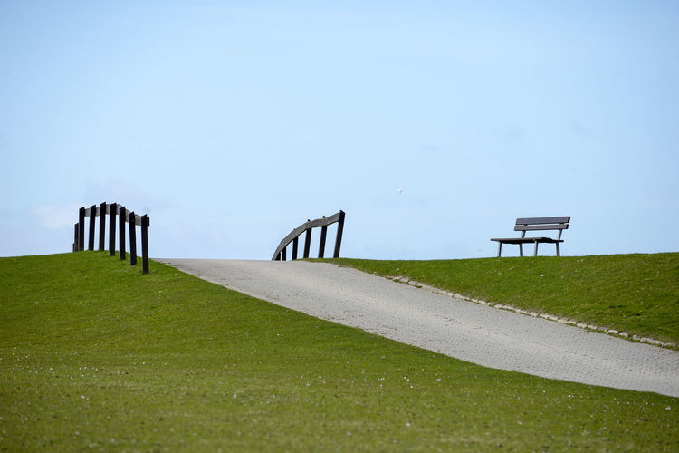 bench on dike Neuwerk Isle Island Lower Saxony Germany North Sea National Park Dike Bench Path Way Nature Tourism Lawn Blue Sky Quiet Idyllic Loneliness Solitude Seclusion Silence Quiet Places