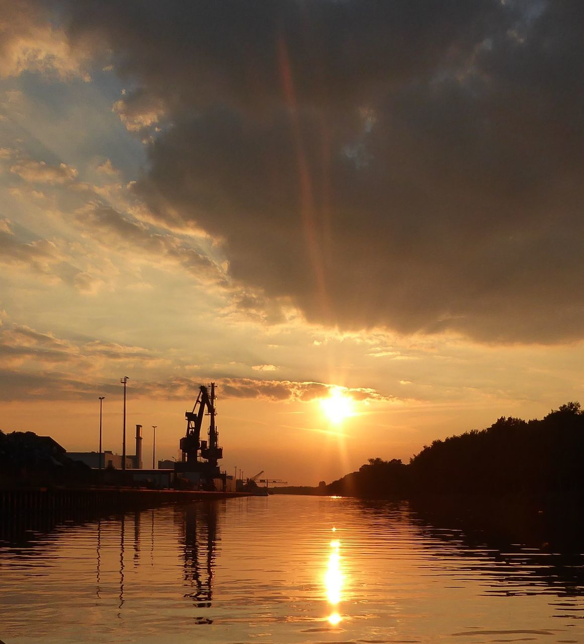 sunset, sky, cloud - sky, water, sun, reflection, silhouette, orange color, beauty in nature, nature, scenics - nature, sunlight, industry, waterfront, no people, tranquility, tranquil scene, outdoors, transportation