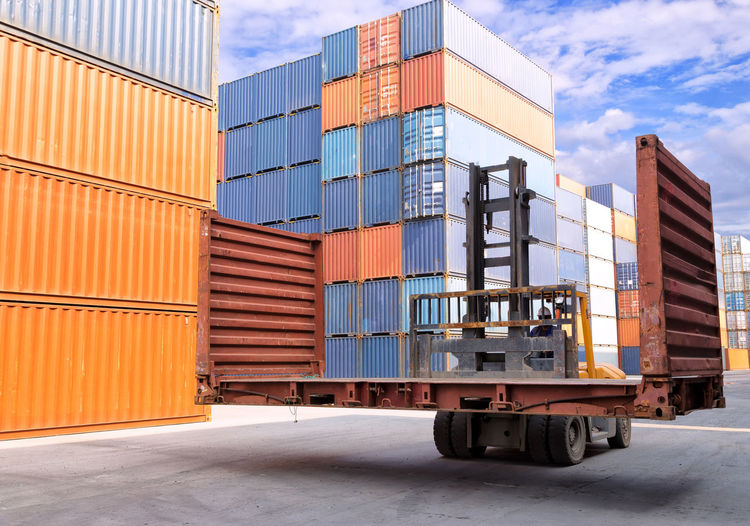 Architecture Business Cargo Container Commercial Dock Container Day Distribution Warehouse Freight Transportation Industry Land Vehicle Mode Of Transportation Nature No People Outdoors Pier Shipping  Sky Stack Transportation Truck