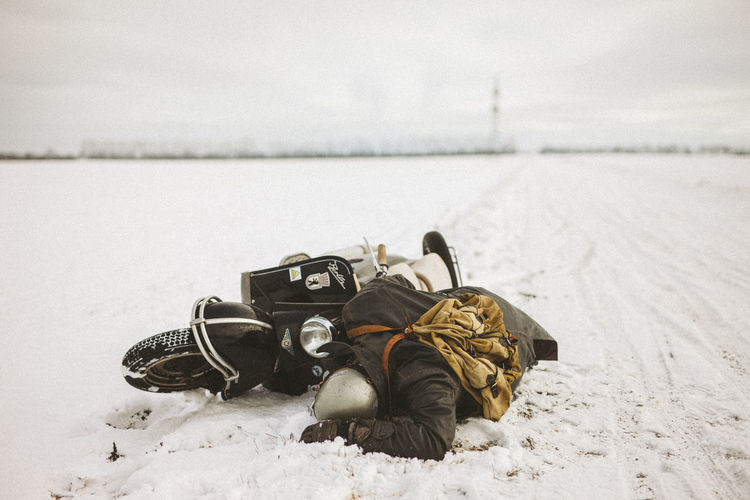 Close-up of shoes on snowy field