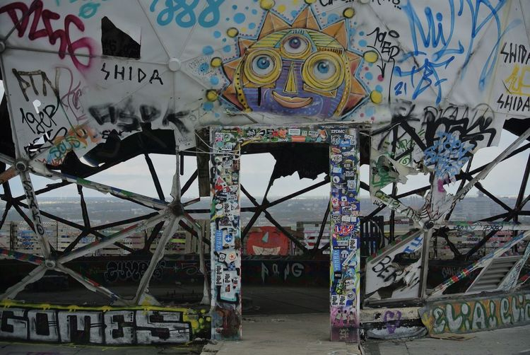 I love this place. Berlin Cool Love Amazing Architecture Art And Craft Building Building Exterior Built Structure Communication Creativity Day Graffiti Multi Colored Mural No People Outdoors Representation Script Sign Street Art Teufelsberg Text Wall - Building Feature Western Script