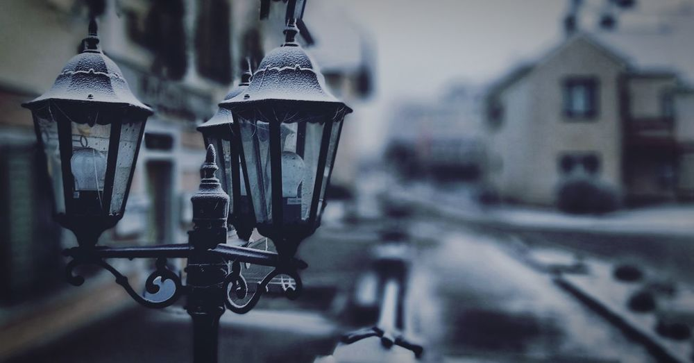 Close-up of lamp post in city