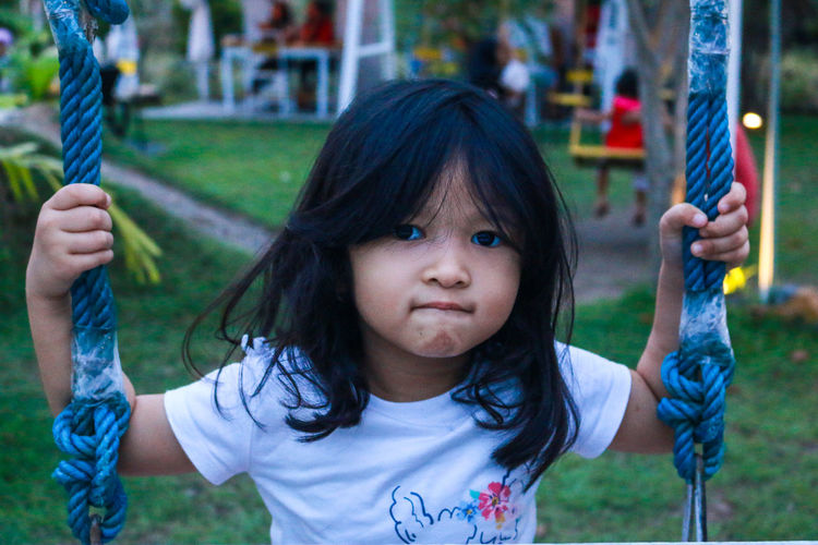 Portrait of cute girl playing in public park