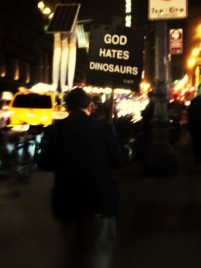 God hates dinosaurs? I've seen this iconic San Francisco man through the years carrying his Signs all over downtown. Mostly it's been political or ad space, but I can't understand his message this time around. Streetphotography
