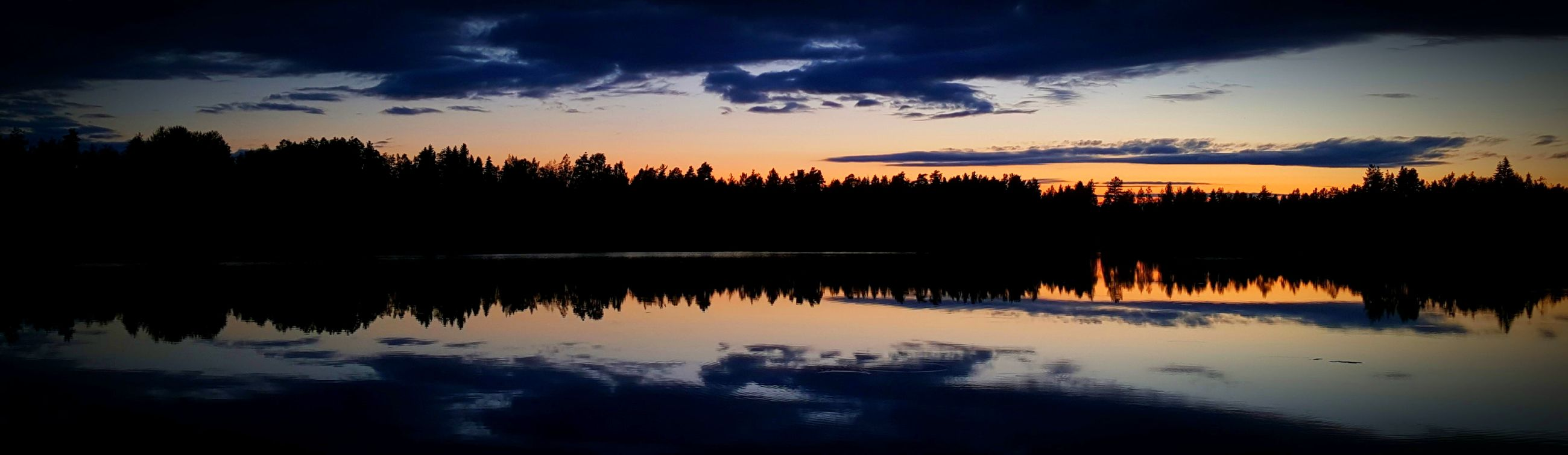 reflection, water, tranquil scene, tree, sunset, beauty in nature, silhouette, tranquility, sky, scenics, nature, lake, no people, cloud - sky, waterfront, outdoors, travel destinations, day