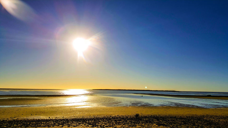 Showcase: November Sea Sun Reflection Sunlight Tranquility Beach Scenics Sunset Horizon Over Water Nature Sky Water Tranquil Scene Outdoors Beauty In Nature Summer Silhouette Refraction No People Eyeem Market Idyllic Atmosphere Tranquility Day