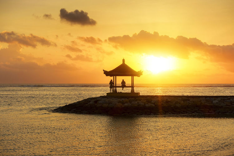 Beautiful Scenery at Karang Beach, Sanur, Bali, Indonesia Holiday Silhouette Vacations Architecture Beach Beauty In Nature Built Structure Cloud - Sky Horizon Horizon Over Water Idyllic Land Nature Orange Color Outdoors Scenics - Nature Sea Silhouette Sky Sunrise Sunset Tranquil Scene Tranquility Water Waterfront
