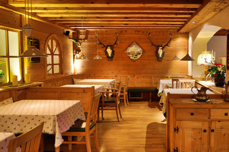 Table Indoors  Lighting Equipment Wood - Material Furniture Seat Chair Absence Food And Drink No People Home Interior Restaurant Hanging Home Domestic Room Architecture Electric Lamp Illuminated Wood Ceiling Clock Antique Light