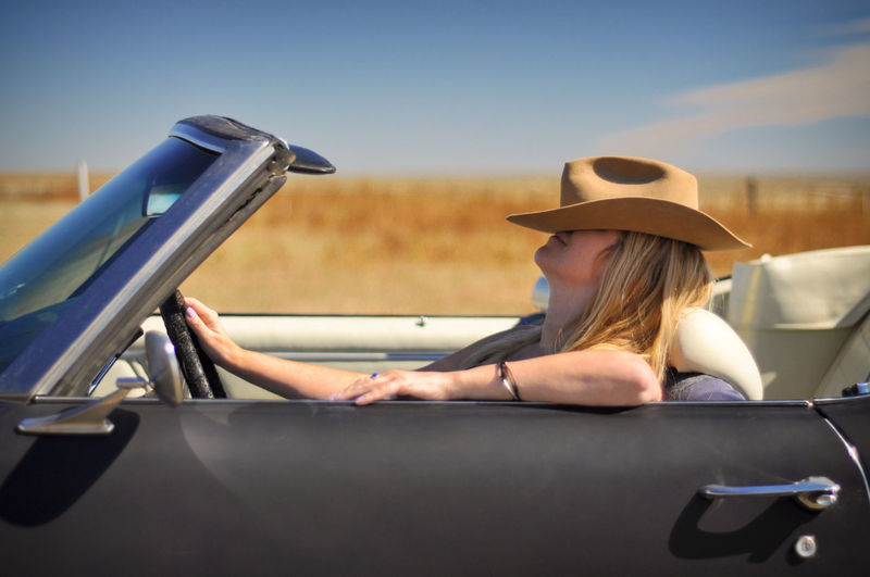 Car Convertible Road Trip Travel Smiling Woman Beautiful Woman Hat Cowboy Hat Cowgirl Rural Scene Countryside Western Country Joyride Motor Vehicle Sitting Happiness Blonde One Person Side View Sunshine Blonde Girl Driving Driver