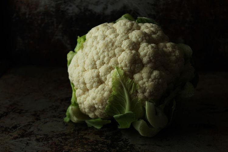 Close-up of cauliflower against black background