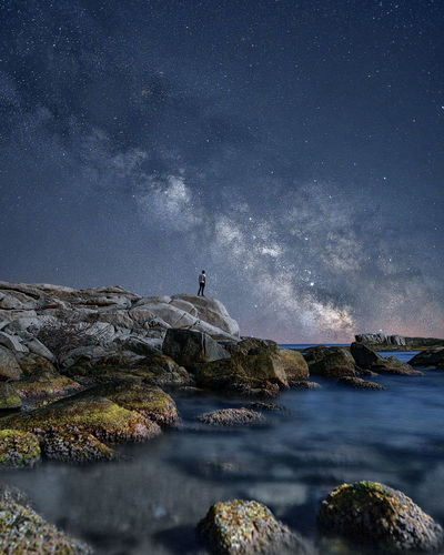 Full length of man looking at starry sky
