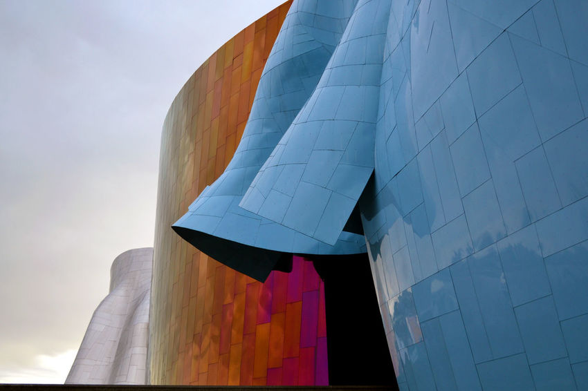 Detail of the EMP museum facade in Seattle Architecture Entrance EyeEmNewHere Frank Gehry Modern Reflection Seattle Space Needle Architecture Contemporary Day Details Emp Facade Building Futuristic Architecture Metal Organic Shapes Outdoors Rail Way Shapes And Forms Steel Structure Texture Train
